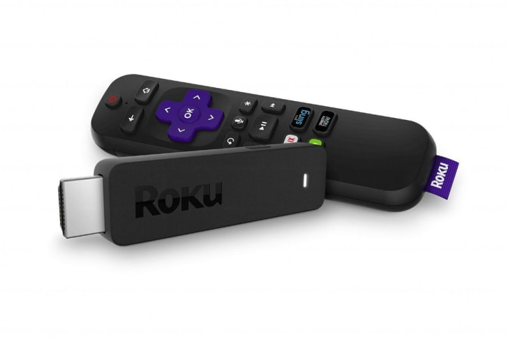 A Roku streaming stick and remote is pictured