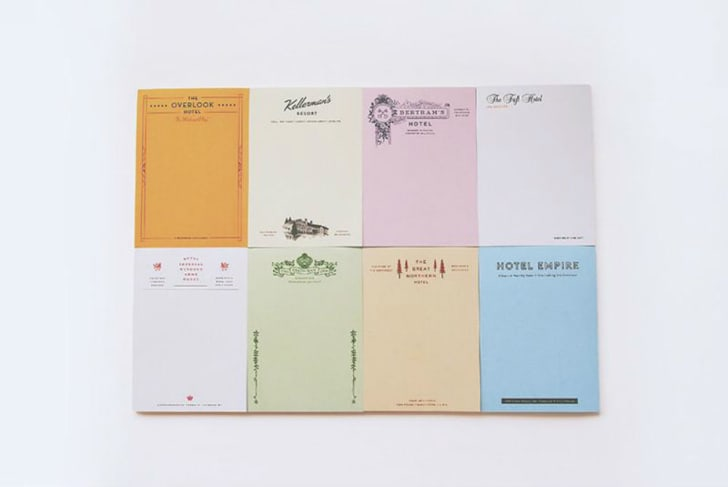 A set of fictional movie hotel notepads is pictured