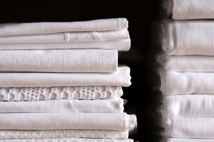 A stack of bed linens.