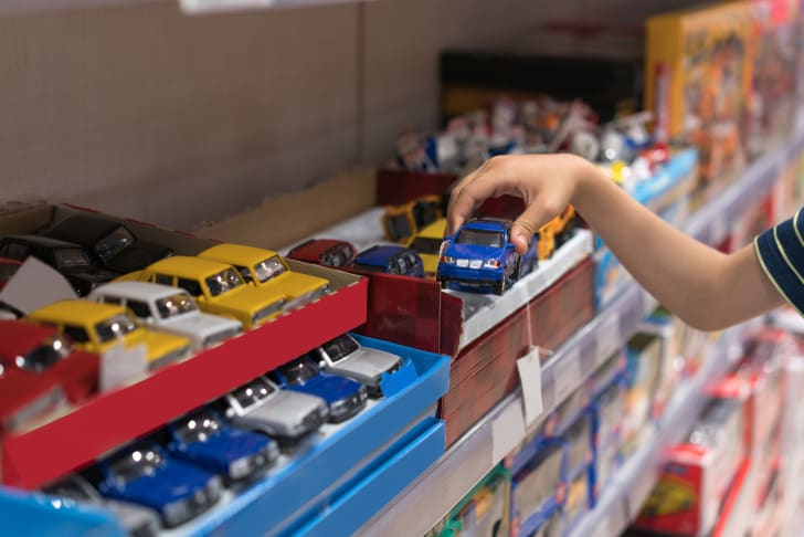 Child choosing a toy car.