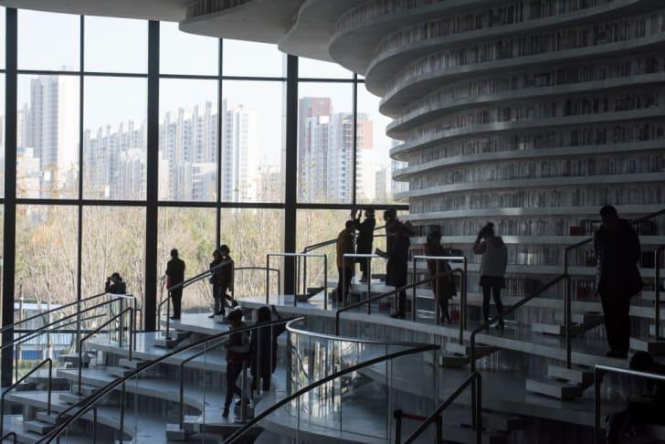 People visiting China's Tianjin Binhai Library.