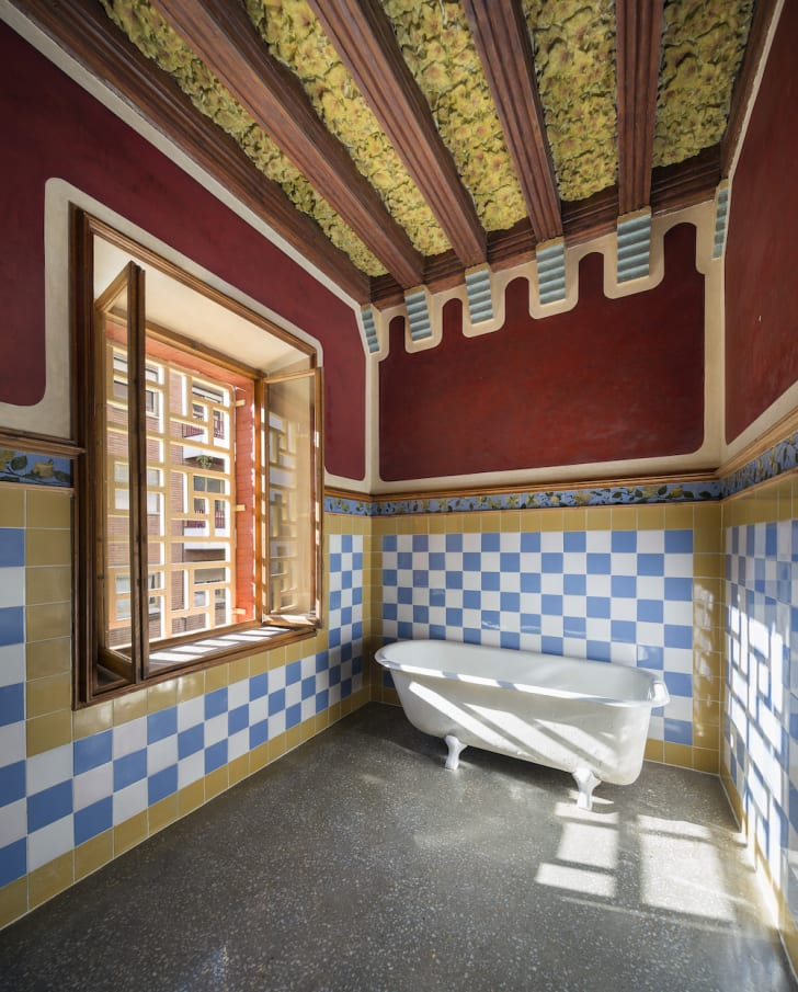 One of the house's blue-and-white tiled bathrooms
