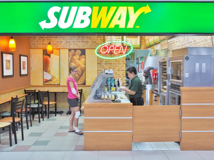 The front exterior of a mall's Subway restaurant