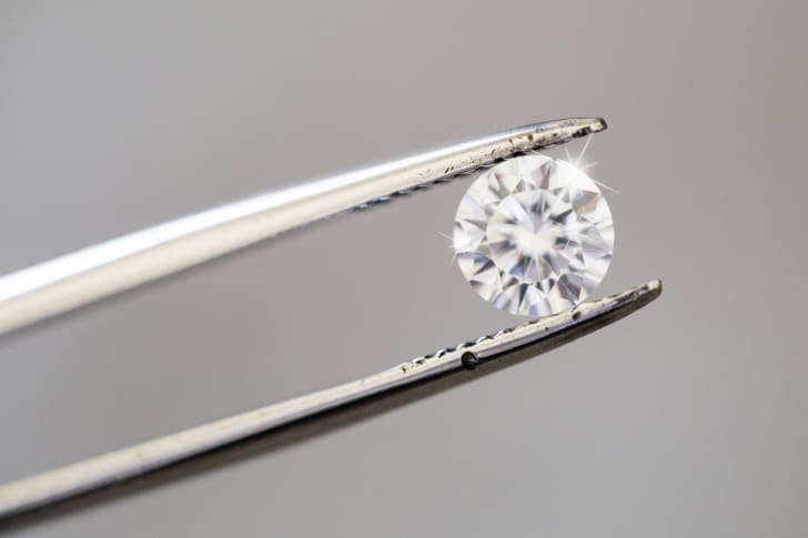 Tweezers holding a diamond.