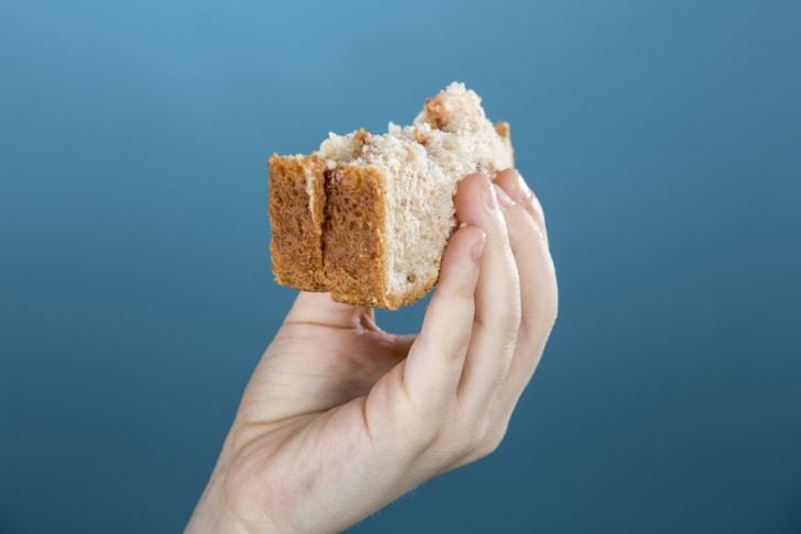 Half-eaten peanut butter sandwich.