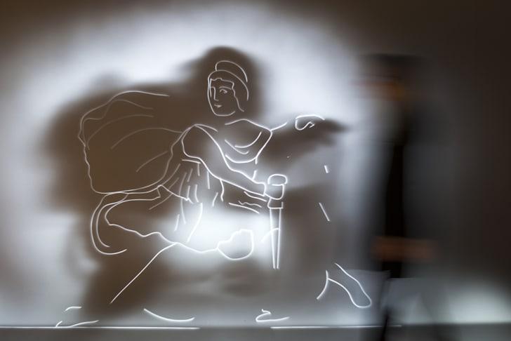 Hazy wallpaper shows Mithras slaying a bull.