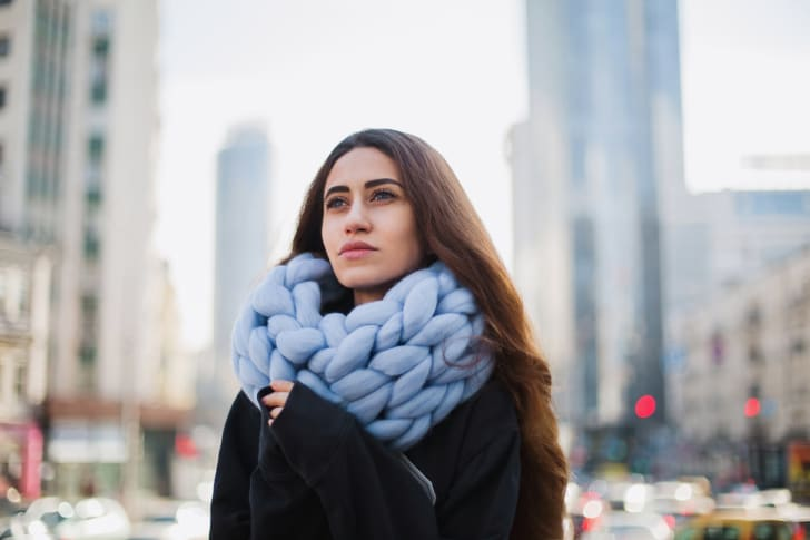 Woman with chunky knit scarf.