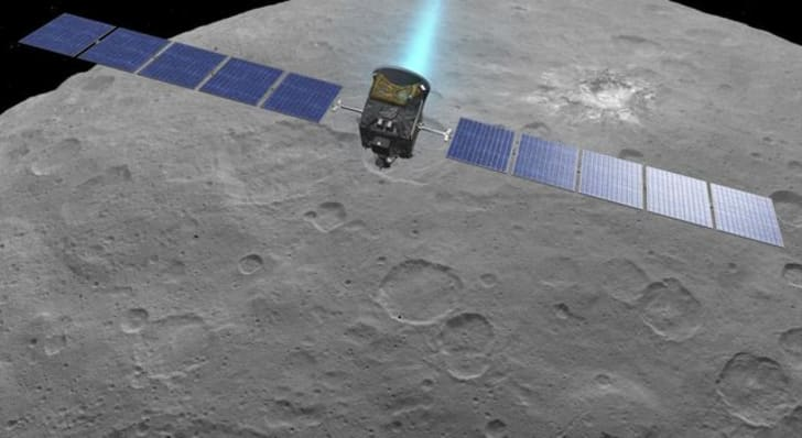An artist's drawing of Dawn firing its engines above Ceres.