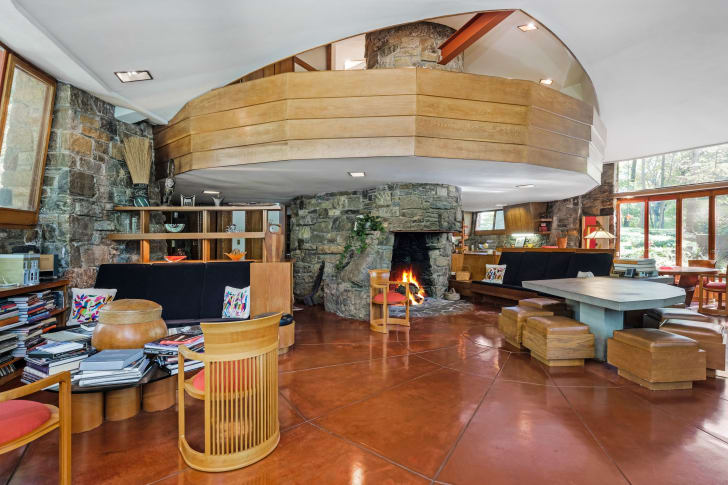 The Sol Friedman House features a stone fireplace, custom-built furniture, and Cherokee Red floors.