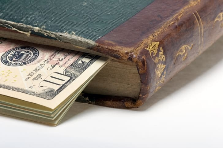 A stack of bills inside an older book