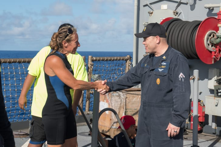 Command Master Chief Gary Wise welcomes aboard Jennifer Appel.