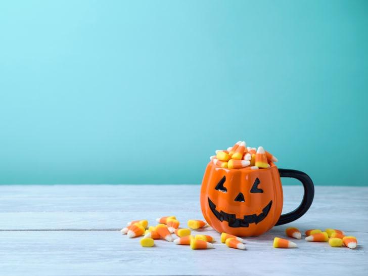 Jack-o-lantern mug full of candy corn.