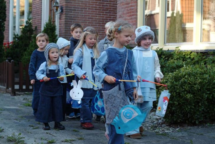 Kids dress up in costume.
