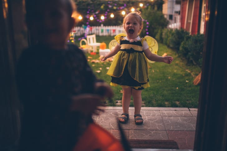 Little girl trick-or-treating.
