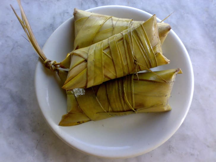 Rice cakes wrapped in leaves.