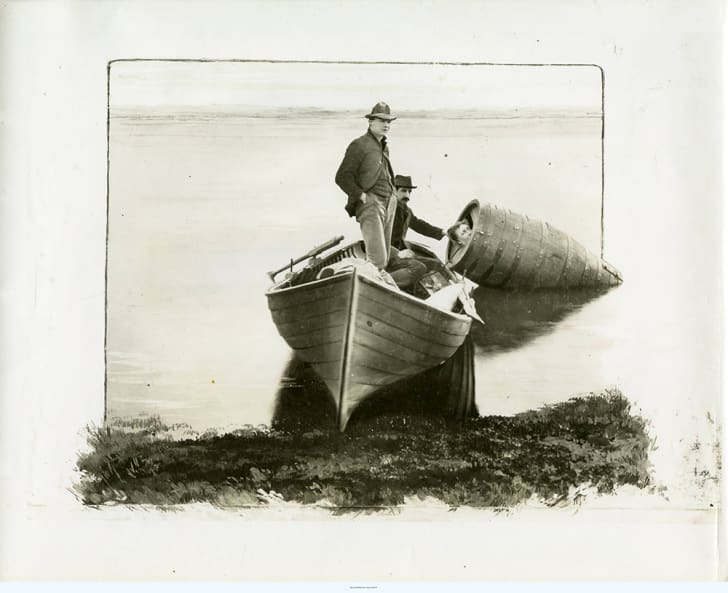 Annie Edson Taylor in barrel with boat