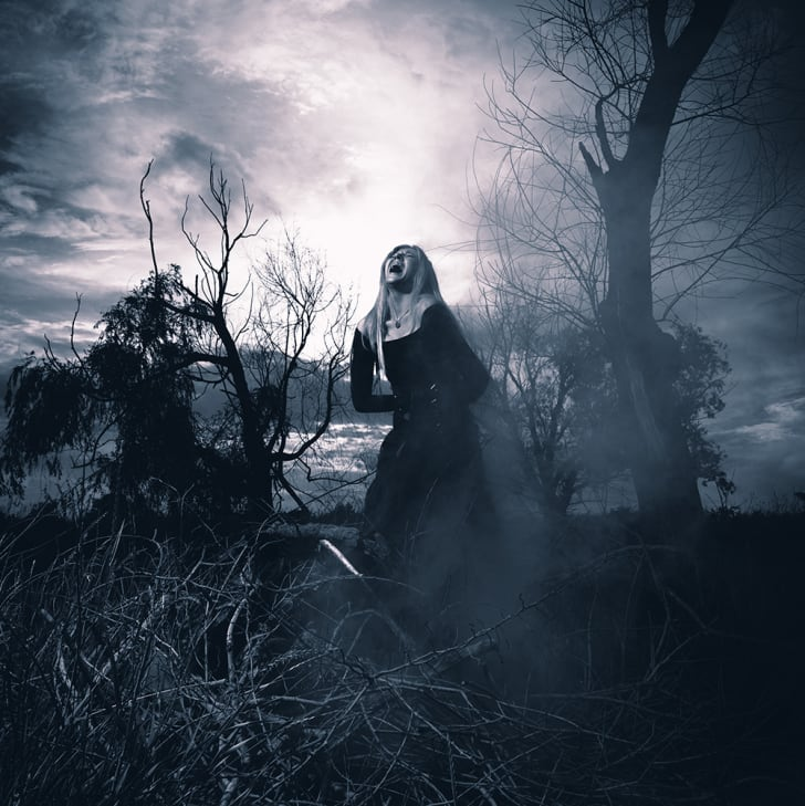 A screaming witchy-looking woman in the fog