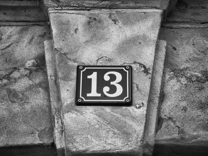 The number thirteen on a street placard