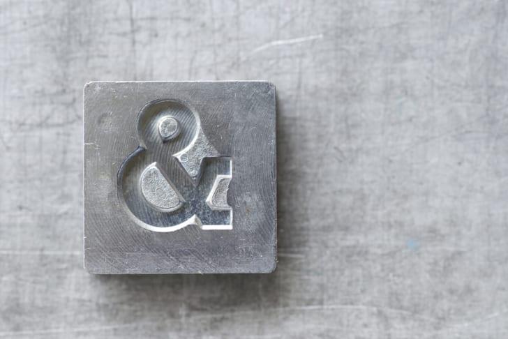 Ampersand symbol on an old metal block