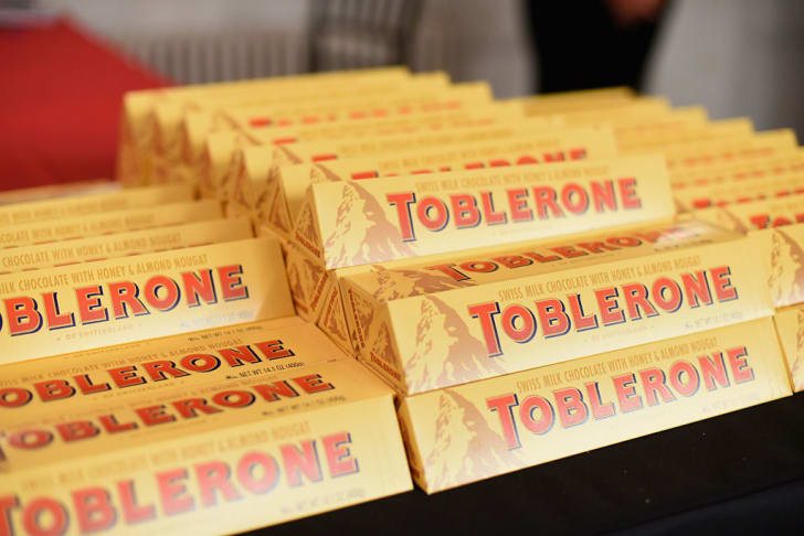Boxes of Toblerone chocolates stacked on top of each other.