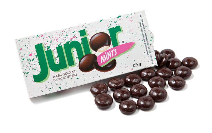 An open box of Junior Mints candy on a white background.