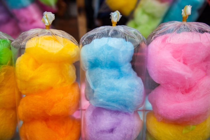 Bags of brightly colored cotton candy in various hues.