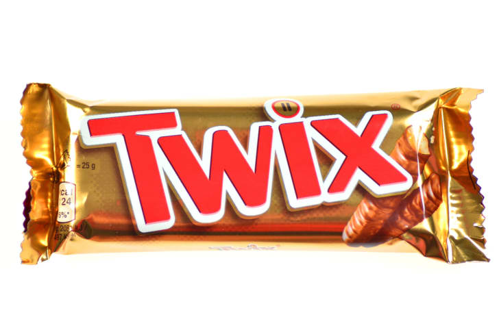 A Twix bar on a white background.
