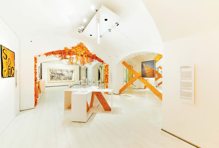 """""""Our Scissors Exhibit,"""" a special art collection inspired by the orange-handled scissors created by Fiskars, on display at the Helsinki Design Museum."""