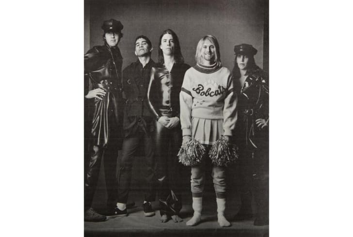 Kurt Cobain wearing a cheerleader outfit in the pages of Rolling Stone