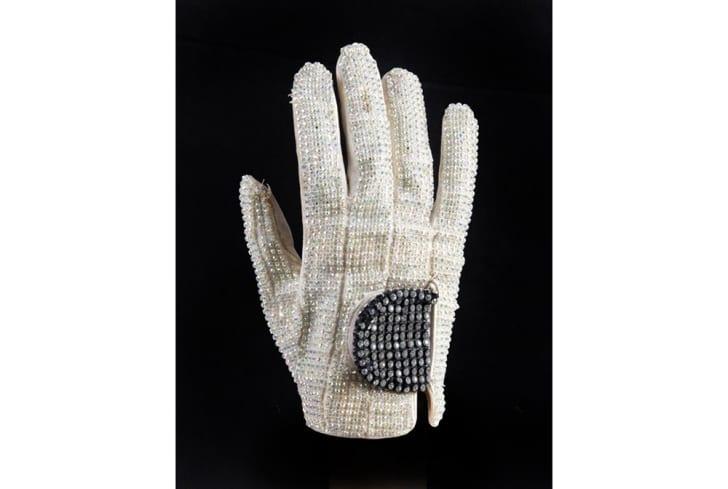 A white glove covered in rhinestones