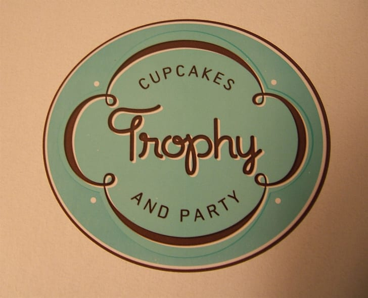 The sign of the cupcake bakery Trophy Cupcakes and Party.