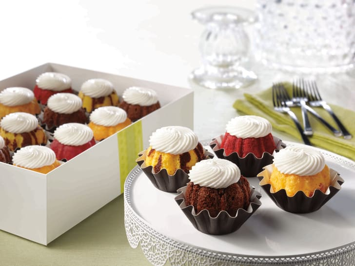Delicious, bundt-cake shaped cupcakes on a tray.