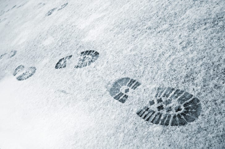 Boot prints in the snow.