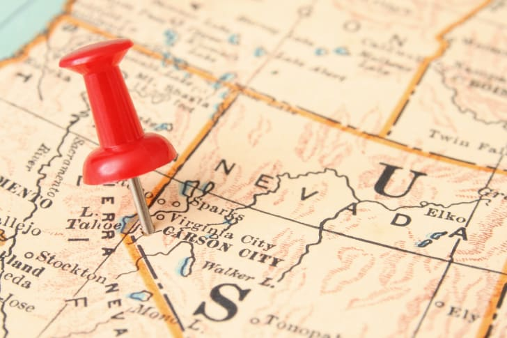 A map of Nevada with a thumb tack in Carson City.