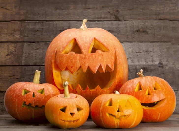 A Halloween display of five jack-o-lanterns