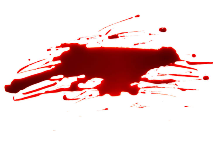 A smear of fake blood on a white background