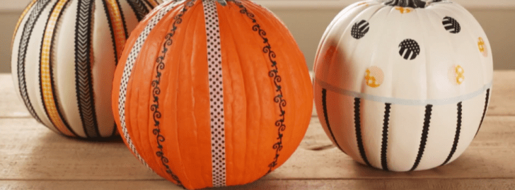 Pumpkins that have been decorated using tape