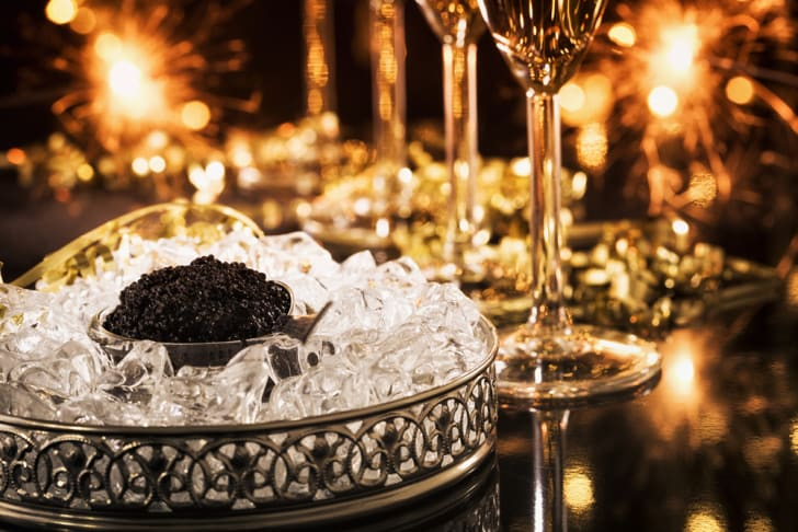 A bowl of black caviar and flutes of champagne