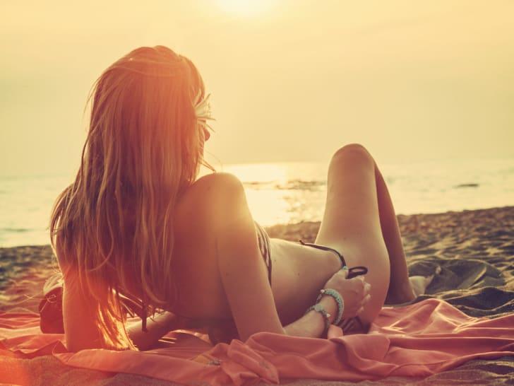 Photo of woman sunbathing