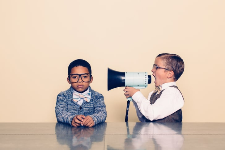 Photo of kid speaking through a megaphone