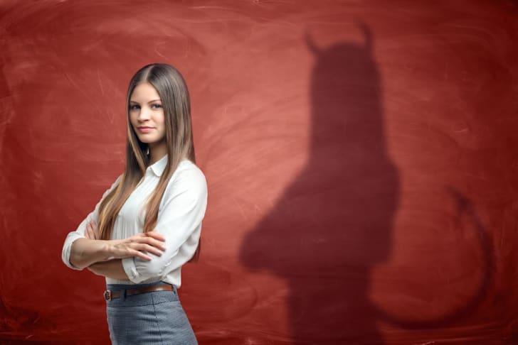 Photo of a woman casting a devilish shadow