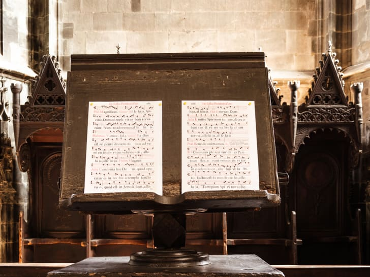 Antique sheet music set up on a church lectern