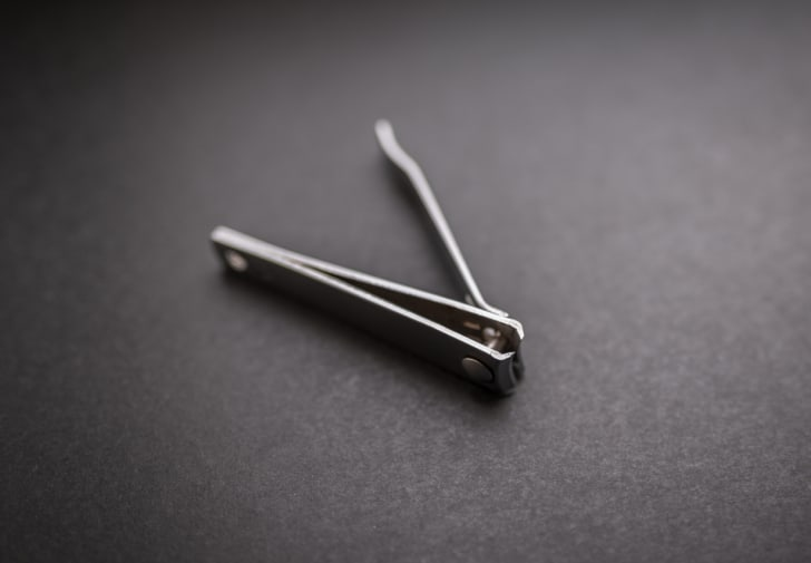 A photo of nail clippers on their side.