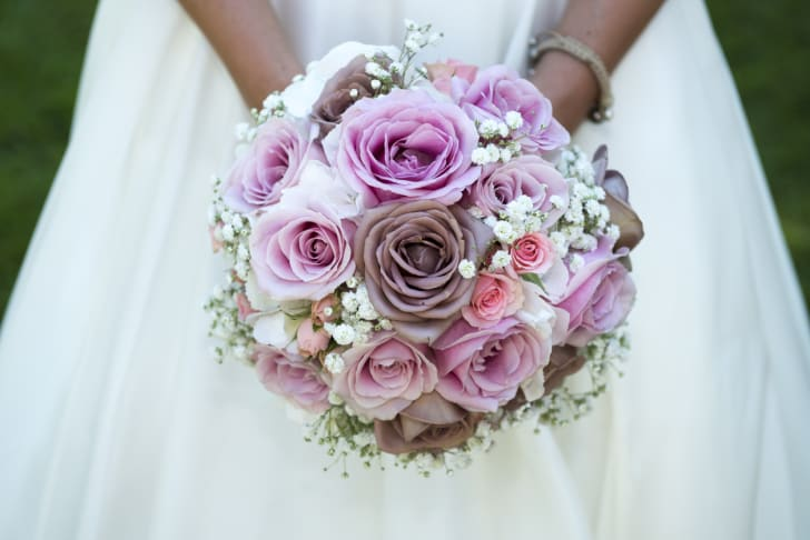 Close-up of a bouquet of flowers being held by a bride.