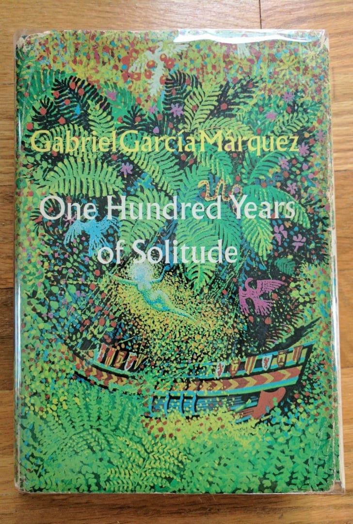 The green, floral, leafy cover of the first edition of One Hundred Years of Solitude.