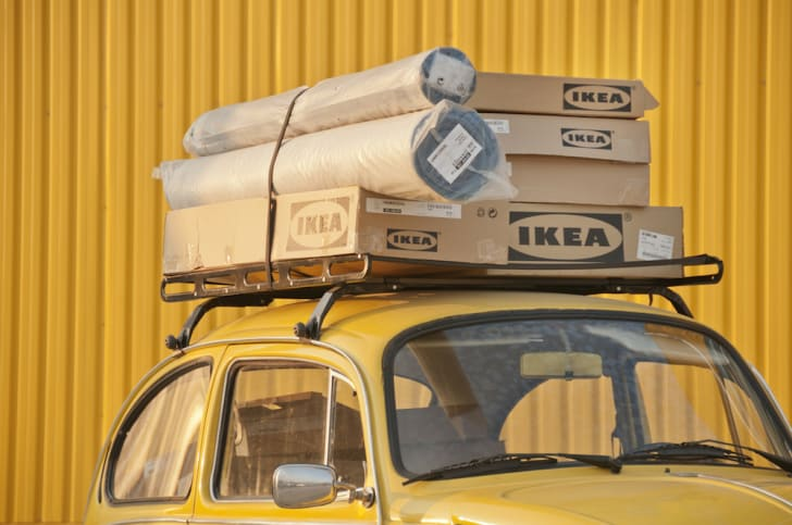 A car topped with boxes of IKEA furniture