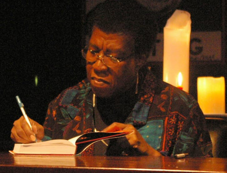 Octavia Butler signs a book at a reading.