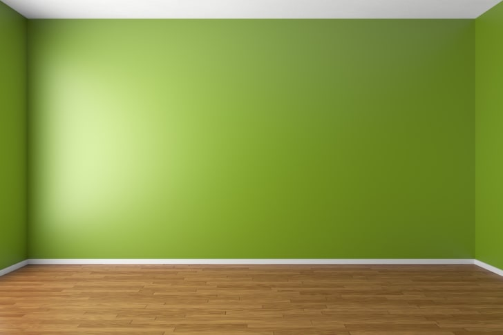 An empty room with green walls.