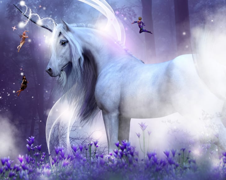 A unicorn in a forest surrounded by fairies.