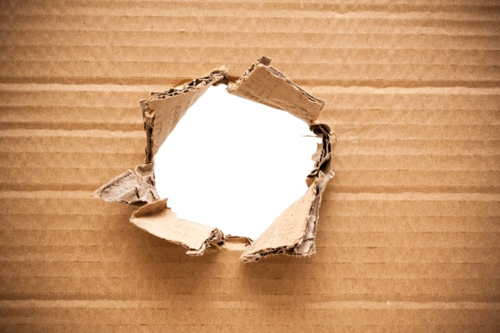 A hole in a piece of cardboard.